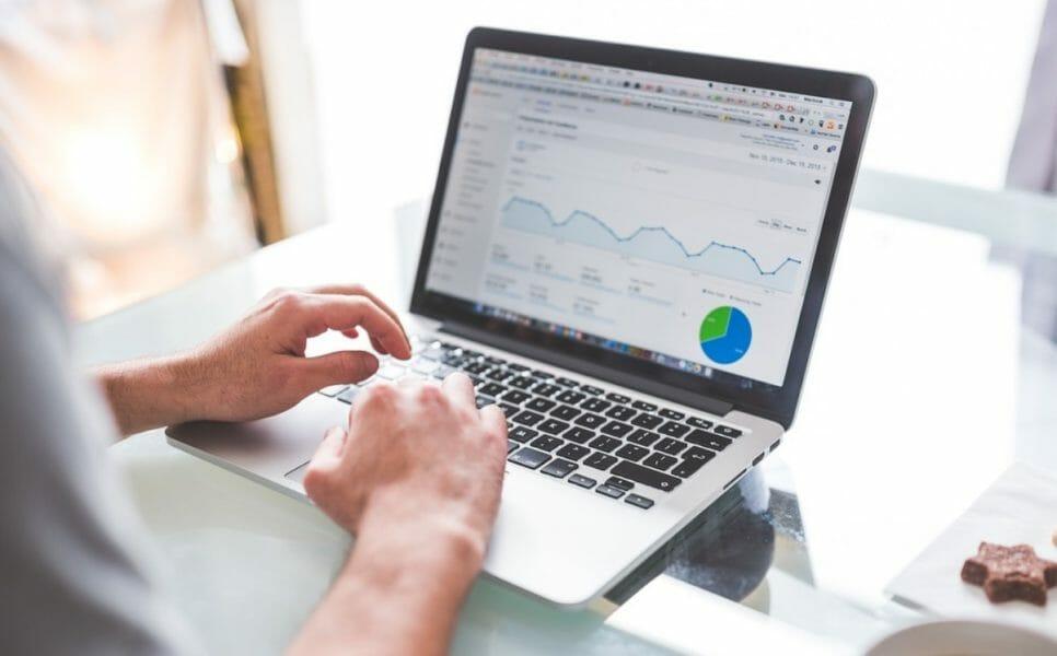 man in laptop doing a website audit