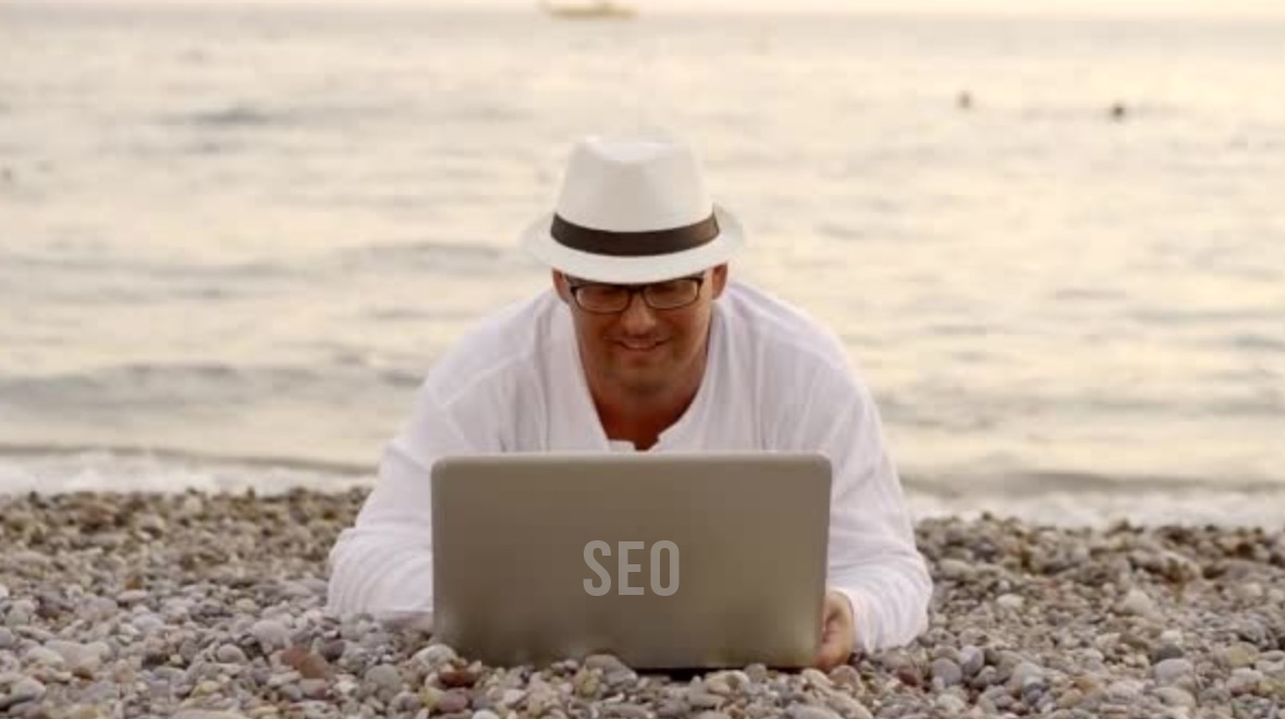man with white hat doing SEO