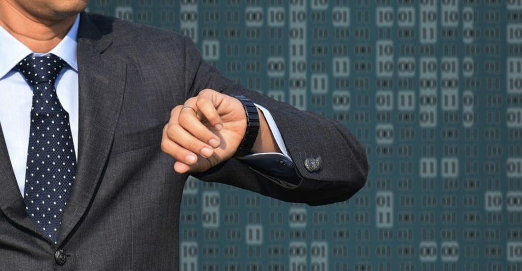 formal man lookiing in his wrist watch