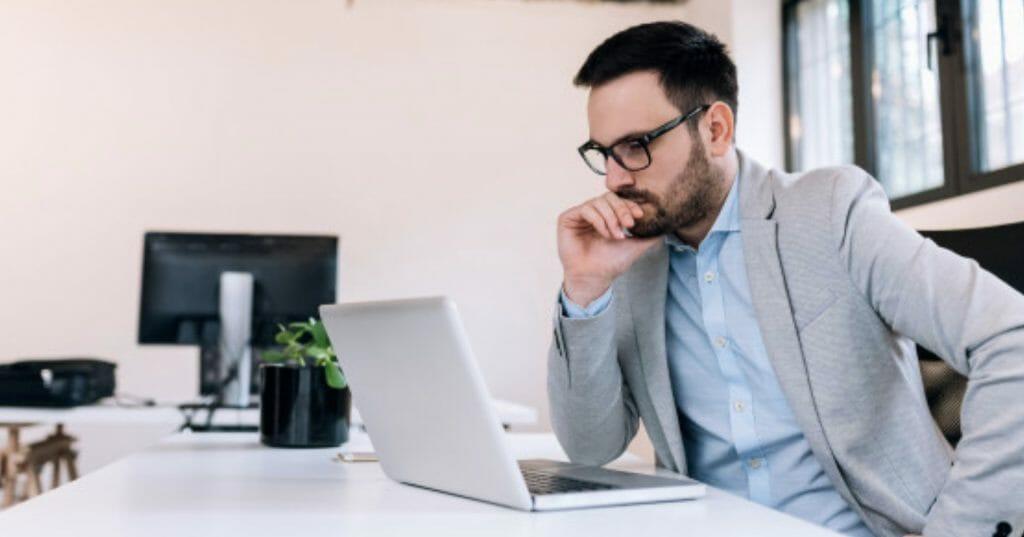 man focusing on his laptop