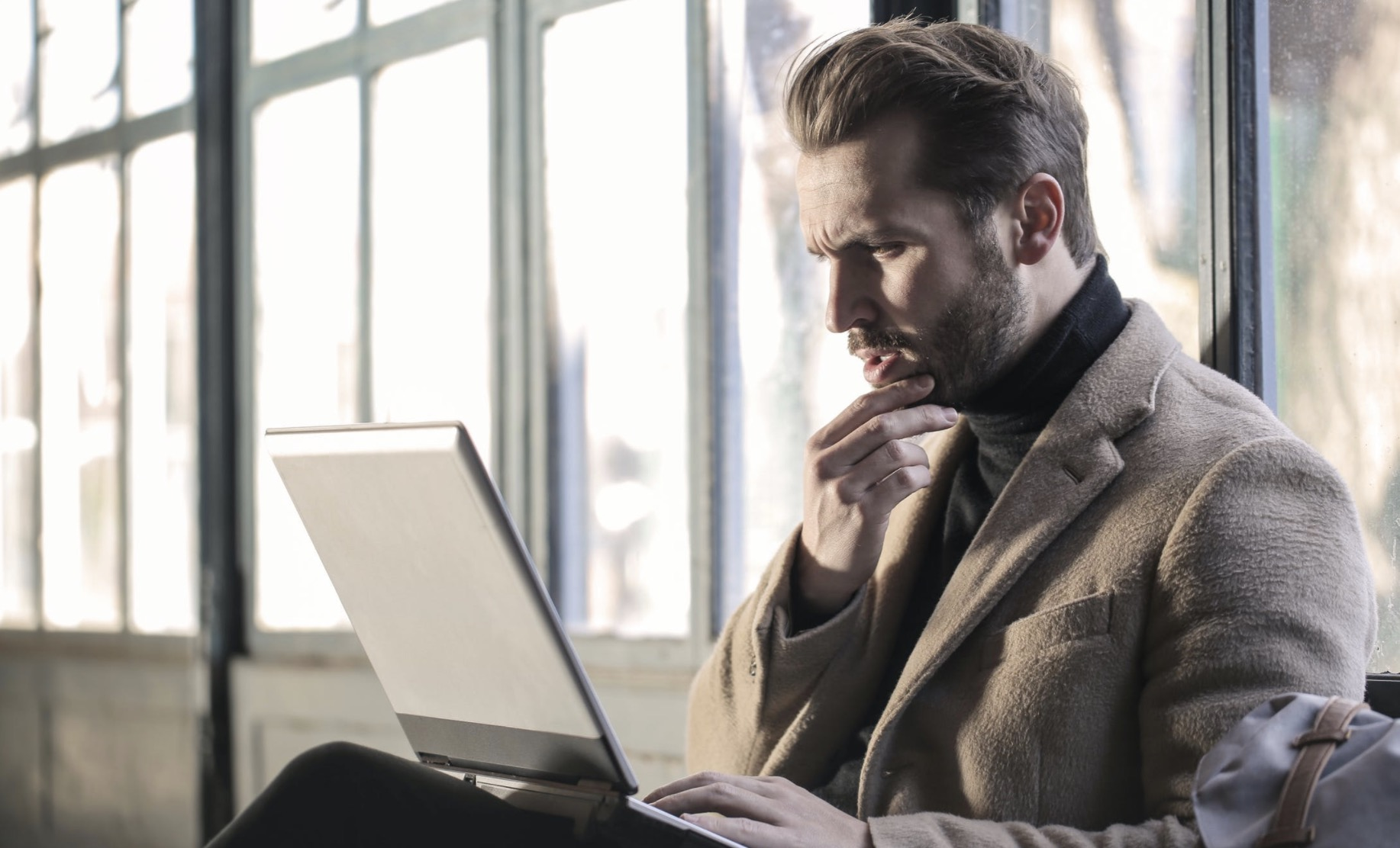 man in awe in front of laptop